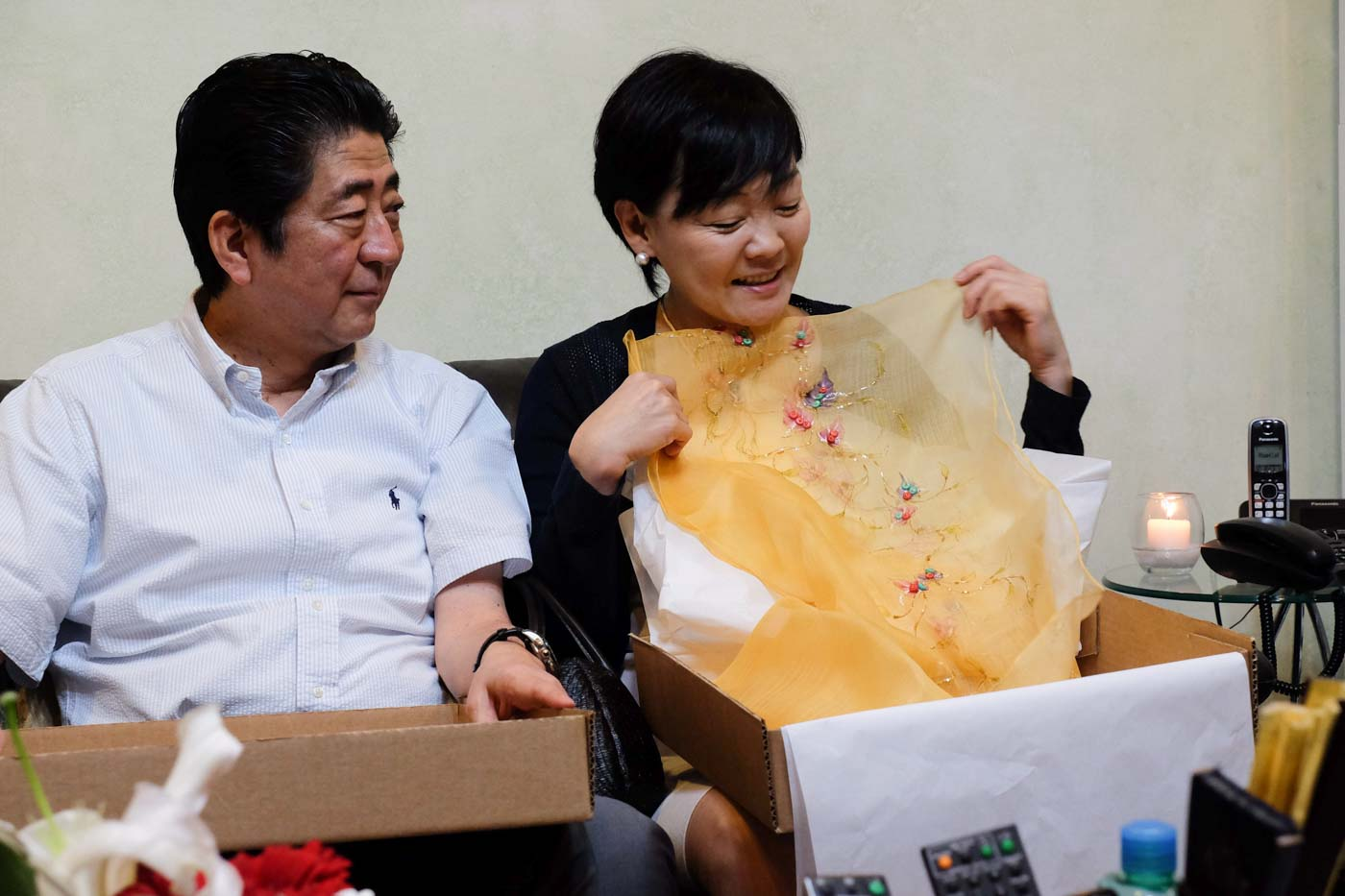 TOKEN FROM DAVAO. Akie Abe, wife of Japan Prime Minister Shinzo Abe, is delighted after receiving a Filipiniana blouse from President Rodrigo Duterte. Photo by Rene Lumawag/PPD