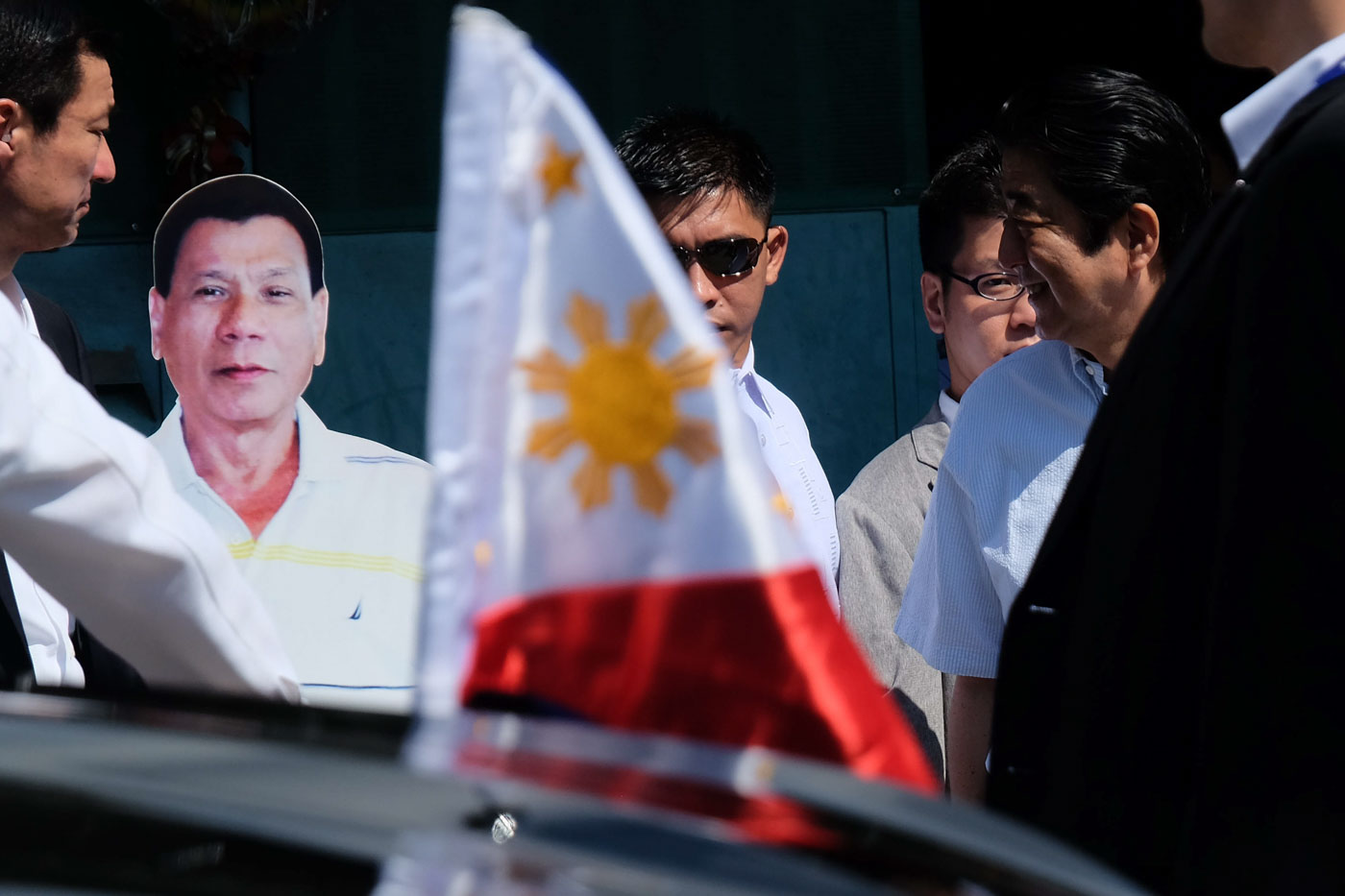 CARDBOARD SENTINEL. Japan Prime Minister Shinzo Abe chuckles upon seeing the standee of President Rodrigo Roa Duterte outside his residence. Photo by Rene Lumawag/PPD