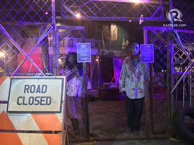 OPEN FOR BUSINESS. Two zombies greet guests at Breakout: The Walking Dead Real Life Escape Room. Photo by Vernise L. Tantuco/Rappler.com
