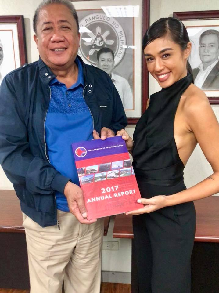 LEARNING. Sandra Lemonon gets a copy of the DOTr report from Secretary Art Tugade during her visit. All photos from Facebook/ Department of Transportation