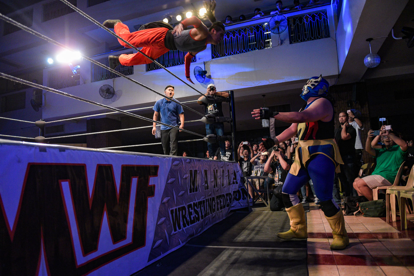 DON'T BLINK. Robin Sane launches himself towards Mr. Lucha on the outside in the first round of the MWF Championship Tournament at MWF: Maki-Wrestling, 'Wag Matakot. Photo by LeAnne Jazul/Rappler