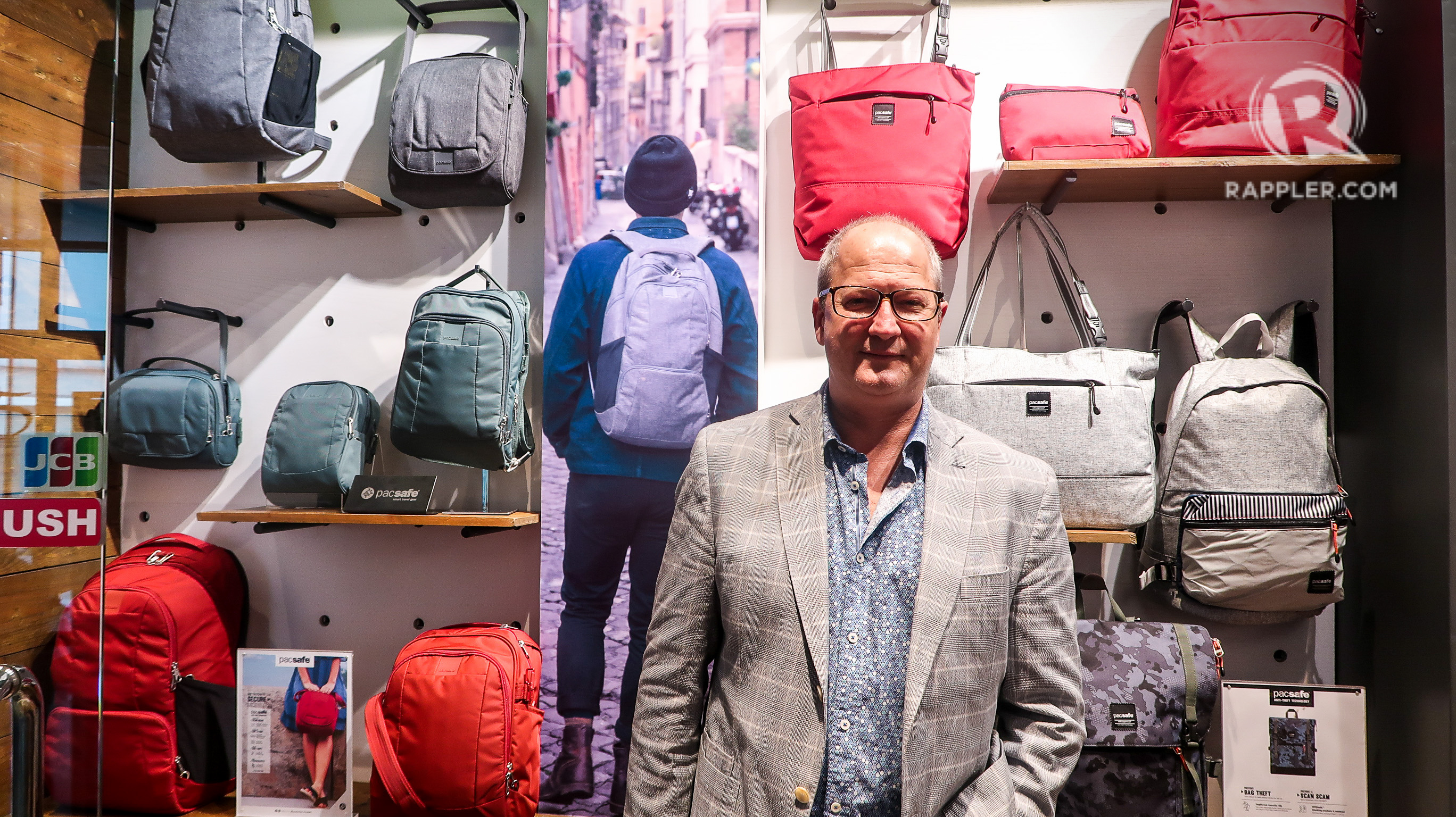 MAGNUS MCGLASHAN. The Pacsafe co-founder poses in front of a Pacsafe store display in the Philippines. All photos by Precious del Valle/Rappler unless otherwise stated
