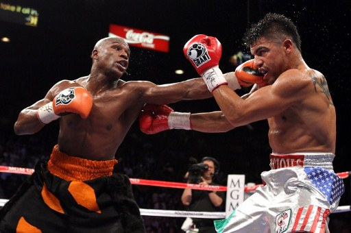 POWER PUNCH: Floyd Mayweather Jr. connects with a left to the face of Victor Ortiz during their WBC welterweight title fightin September 2011. Al Bello/Getty Images/AFP