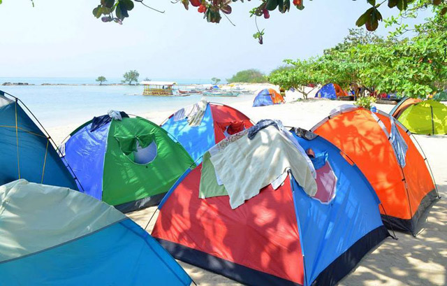 ROUGHING IT.  Camping is the way to stay in many unspoiled beaches like Burot. Photo by Paula Anntoneth O