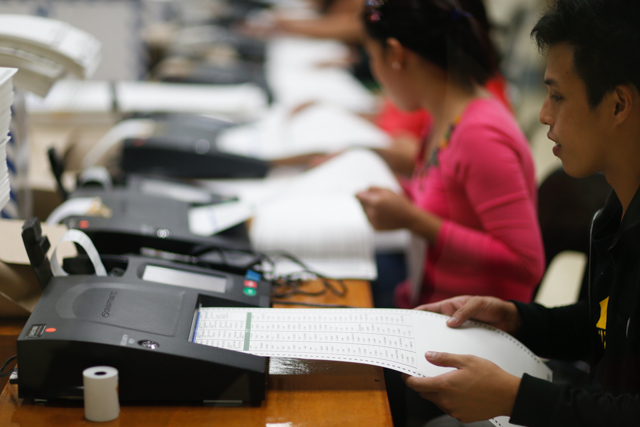 STRAY OR NOT? An employee tests the ballots to identify spoiled ones, which will then be destroyed. Photo by Rappler/John Javellana