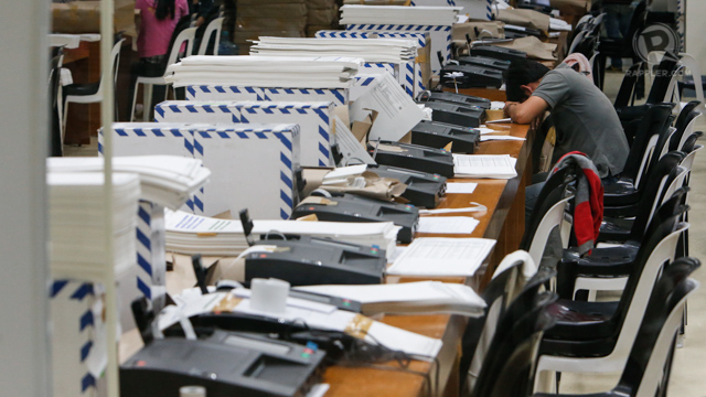 PCOS TEST. To ensure ballots will work on May 13, each of these passed through a PCOS machine. File photo by Rappler/John Javellana