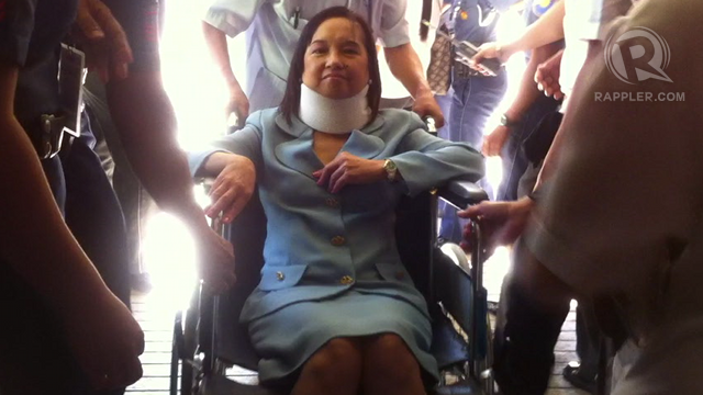 AFTER ARRAIGNMENT. Former President Gloria Macapagal-Arroyo leaves the Sandiganbayan in a wheelchair after she entered a u0022not guiltyu0022 plea in connection to graft charges.