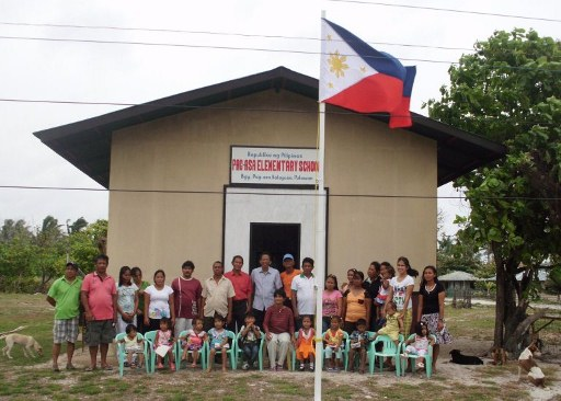 FACING CHINA. A kindergarten school is the newest major structure built in Kalayaan, one of the poorest Philippine towns that is likely to clash with a new Chinese city. Photo from AFP/Office of the Kalayaan Mayor
