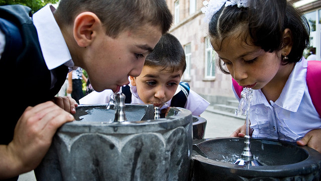 CLEAN START. Armenia children drink fresh water from a fountain built as part of an ADB funded project. All photos from the ADB