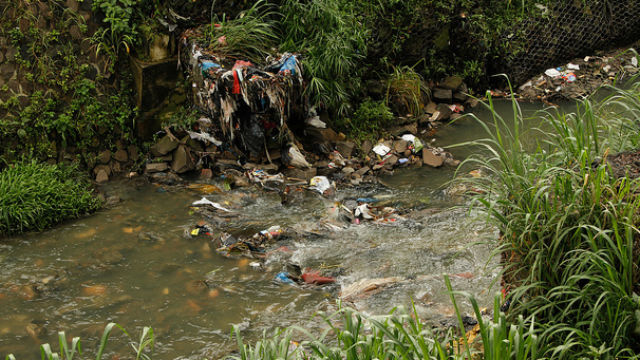 LEFT OVERS. Trash lines a river in the center of Bandung, West Java in Indonesia