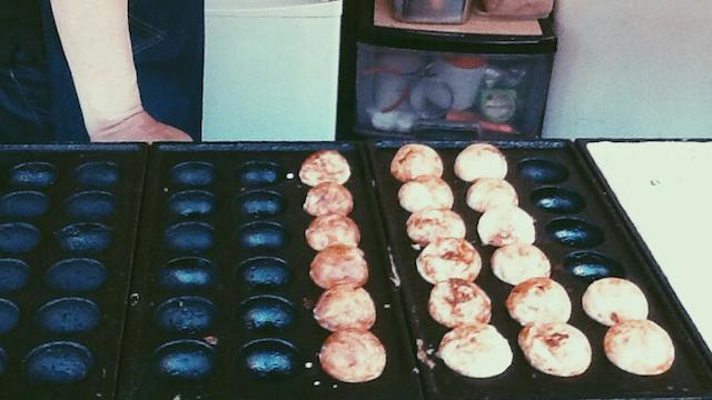 TAKOYAKI! These savory octopus balls are served piping hot along many Osaka sidestreets.