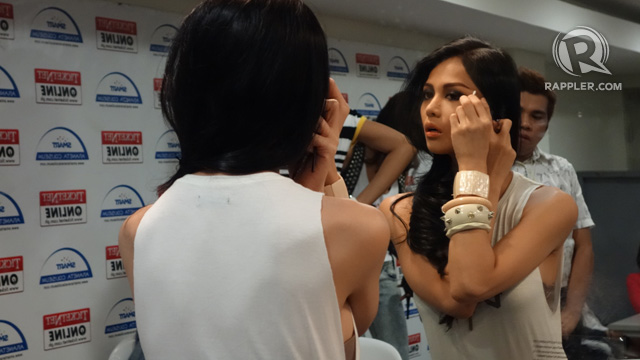 FINISHING TOUCHES. A candidate fixes her eye makeup