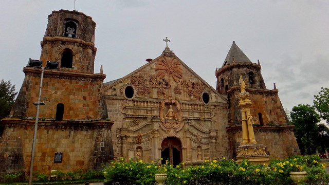 ONE-OF-A-KIND CHURCH. Santo Tomas Church in Miag-ao, Iloilo is easily noticeable for its golden brown fau00e7ade and its reliefs of saints and local life. Photo by Rhea Claire Madarang
