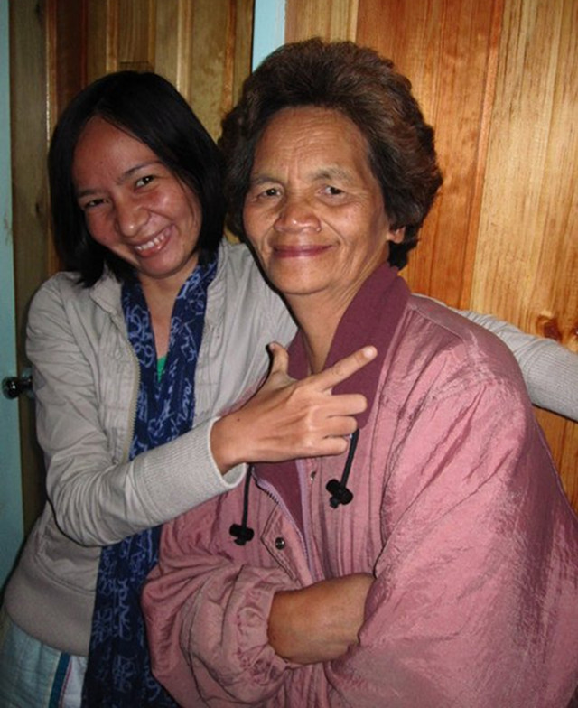 THE AUTHOR WITH MARY DAOAS. Mary (or Tita Mary to visitors in Sagada) gladly posed for a memento picture inside her lodging house. Photo courtesy of Eleazar Cuela
