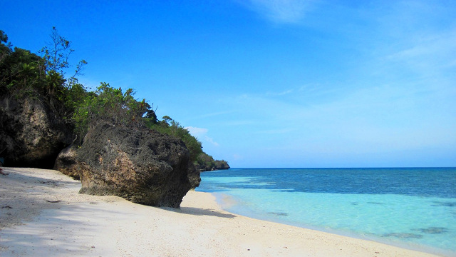 SECRET BEACH. Kagusuan Beachu2019s out-of-the-way location is part of its charm. Photo by Eileen Campos