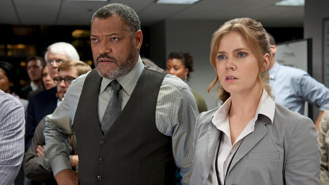 THE JOURNALISTS. Laurence Fishburne plays Daily Planet editor-in-chief Perry White while Amy Adams plays journalist Lois Lane