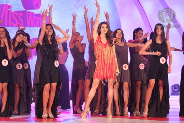 Miss World Philippines 2012 Queenierich Rehman opens the show with a song number, the candidates her back-up dancers