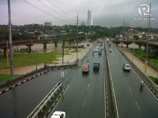 SWELLED BY RAIN. An overflowing Marikina River viewed from Marcos Highway near SM Marikina. Photo courtesy of Krista Garcia