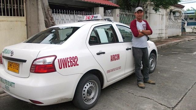 AT YOUR SERVICE! The happy driver who picked me up the morning I used GrabTaxi, Jophel Calipayan