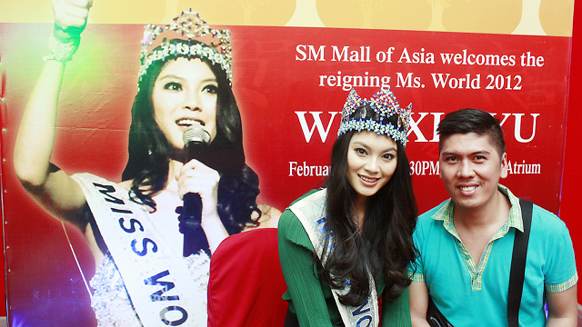 REIGNING MISS WORLD. Sash Factor's Dennis Natividad [right] with Miss World 2012 Wenxia Yu. Photo courtesy of Dennis Natividad