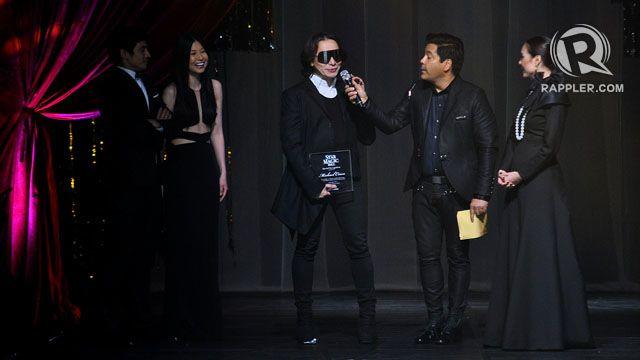 RECOGNITION. Dubai-based designer Michael Cinco receives a plaque from Star Magic