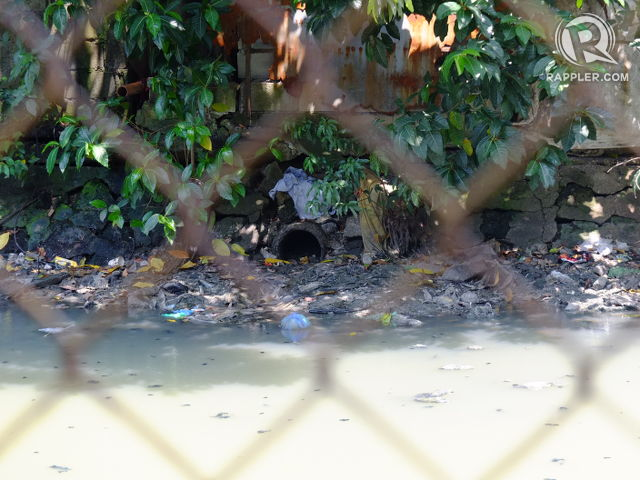 WASTE DEPOSITORY. Pipes, many connected to toilets, dump wastes straight into a creek in Paco, Manila
