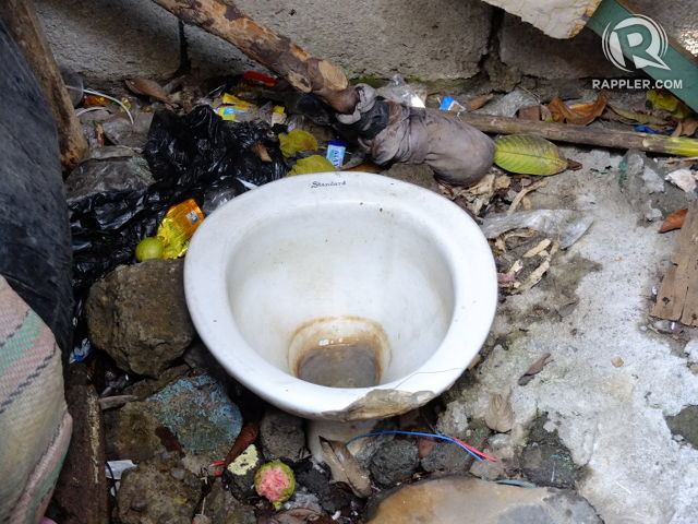 NOWHERE ELSE TO GO. A toilet beside the creek deposits human waste into the body of water