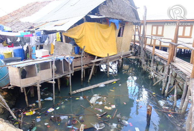 FILTH. Garbage floats on the waters of Coron Bay under a house with chicken cages, another source of filth if not maintained properly