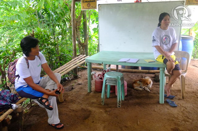 COMMUNITY-BASED REFORESTATION. Forester Tess Argota and village organization president Virginia Banaga in the village office in Calawis where they keep the seedling nursery