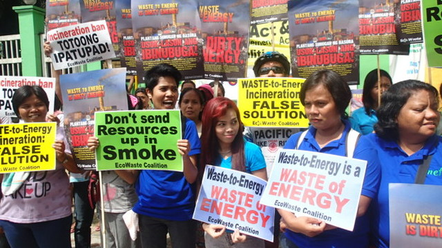 'DIRTY ENERGY.' Groups protest the crafting of guidelines for waste-to-energy incineration in the Department of Environment and Natural Resources compound in Quezon City on August 12, 2014. Photo courtesy of EcoWaste Coalition