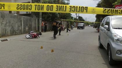 CRIME SCENE. Scene of the crime operatives block a portion of Maestra Vicente St, Brgy Sta. Maria in Zamboanga City where university president Arturo Eustaquio III was shot Sunday afternoon.