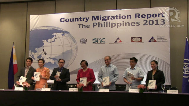 PEOPLE BEHIND THE STUDY. (L-R) IOM program officer Ricardo Casco, CFO secretary Imelda Nicolas, IOM Chief of Mission Marco Boasso, DOLE Sec. Rosalinda Dimapilis-Baldoz, author Fr. Graziano Battistella, POEA Administrator Hans Leo Cacdac pose after the ceremonial signing of the Country Migration Report. Photo by Sam Evardone.