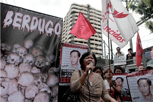 THE MOTHER. School principal Concepcion Empeu00f1o, mother of Karen Empeno, speaks at a rally outside the DOJ. Photo by Geric Cruz