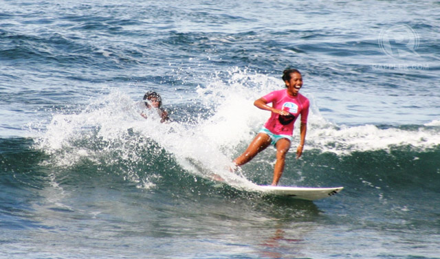 SURFING CHAMP. Nilve Blancada as she finished her ride during the Finals. Her smile shows that she knew she was the champion of the Roxy Siargao International Comp! Photo from Elaine Abonal