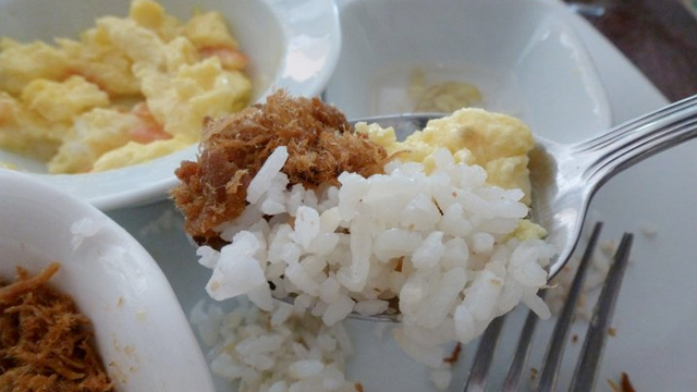 RICE PLUS. Garlic rice and eggs complete the delight.