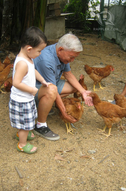 LUIS, LOLO AND CHICKENS. Luis gets to experience moments like this that other kids don't. Photo from Bubbles Saldavor