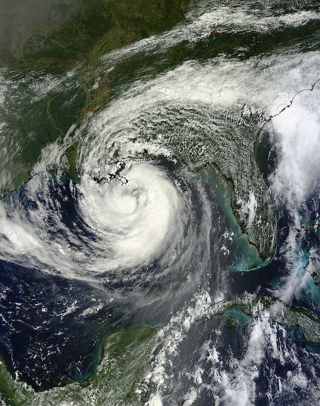 The MODIS instrument on NASA's Terra satellite captured a visible image of Hurricane Isaac as it approached Louisiana on Aug. 28 at 12:30 p.m. EDT. A large band of showers and thunderstorms stretched from the Carolinas, west over Georgia, Alabama, Mississippi, Florida and into Louisiana, wrapping into Isaac's center of circulation when it was centered about 100 miles south of the mouth of the Mississippi River. Credit: NASA Goddard MODIS Rapid Response Team