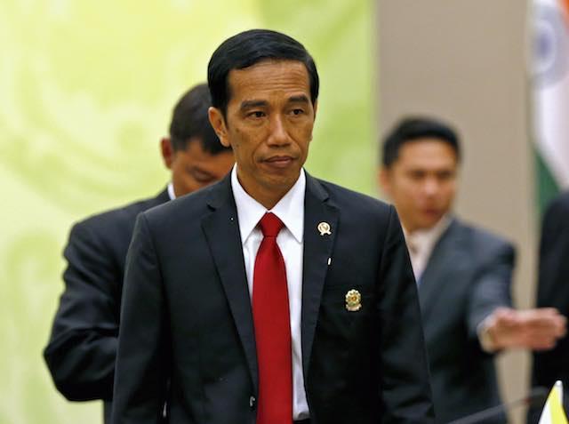 Presiden Jokowi mengaku tak tahu apa yang ditandatanganinya. Foto oleh EPA