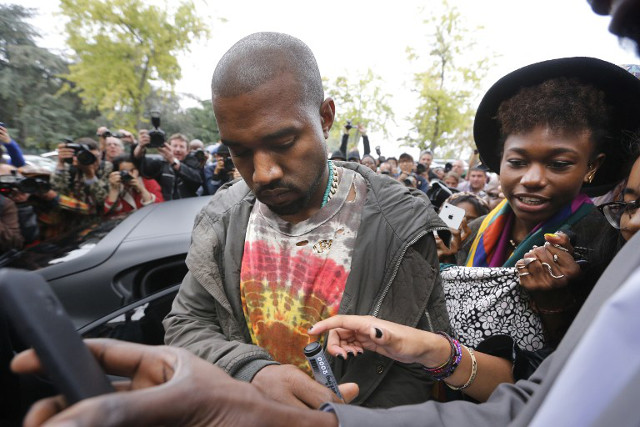 DON'T MAKE ME ANGRY. Kanye West signing autographs in Paris. Photo: Joel Saget/AFP