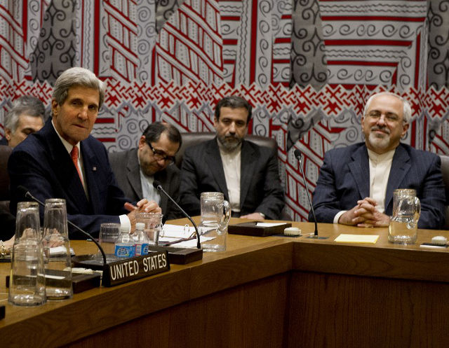 UNPRECEDENTED TALKS. US Secretary of State John Kerry (L) and Iran's Foreign Minister Mohammad-Javad Zarif (R) attend a meeting to discuss Iran's suspect nuclear program September 26, 2013 on the sidelines of the General Assembly at UN headquarters in New York. AFP PHOTO/Stan Honda