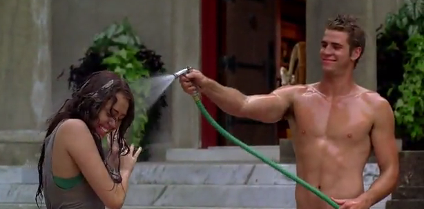 HUNK FROM DOWN UNDER. Hemsworth with his new fiancee in a scene from 'The Last Song.' Screen grab from YouTube
