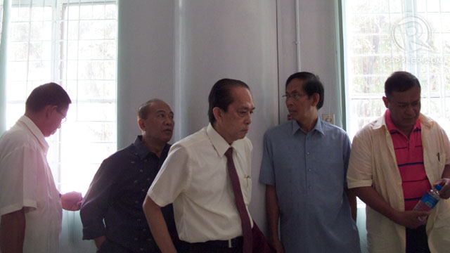 ACCUSED. Osorio (far left), Palparan (fourth from left) and Hilario (far right) wait at the Department of Justice after a hearing. Photo by Carlo Gabuco