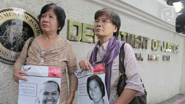 STILL SEARCHING. The mothers of Sherlyn Cadapan and Karen Empeu00f1o wait outside the Department of Justice. Photo by Geric Cruz