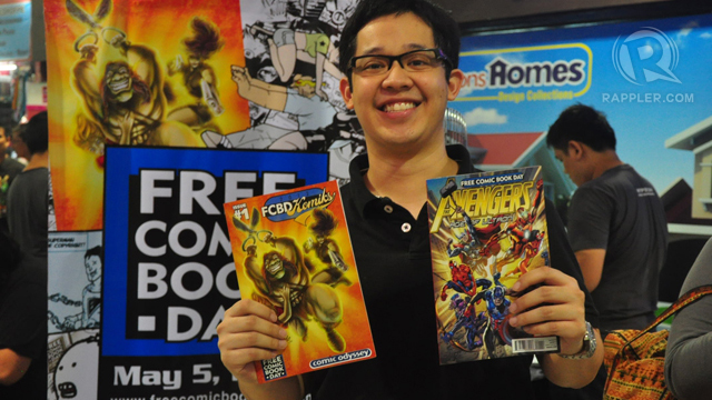 HAPPY HERO'S GRANDSON. Jiggy Cruz beams with happiness over his free comics. Photo by Jerald Uy