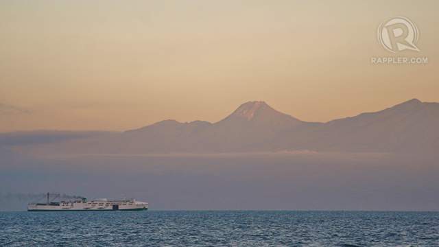 TOWERING GIANT. A huge shipping vessel passing by the Davao Gulf was dwarfed by the towering Mt. Apo. Photo from Karlos Manlupig