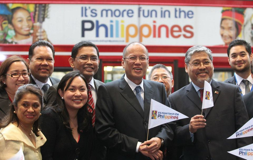 President Benigno Aquino III (center), along with members of his cabinet and other government officials, pose infront of a double-decker bus during a photoshoot for the u0022It's more fun in the Philippinesu0022 tourism campaign in London, June 5, 2012. Photo by Malacau00f1ang Photo Bureau