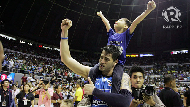 VICTORIOUS. Marc Pingris carries his son on his shoulders after carrying the SanMig Coffee Mixers in Game 7 of the PBA Governors' Cup Finals. Photo by Josh Albelda/Rappler