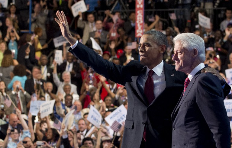 ENDORSED. US President Barack Obama waves alongside former US President Bill Clinton after Clinton's speech during the Democratic National Convention (DNC) at the Time Warner Cable Arena in Charlotte, North Carolina, on September 5, 2012. AFP PHOTO / Saul LOEB