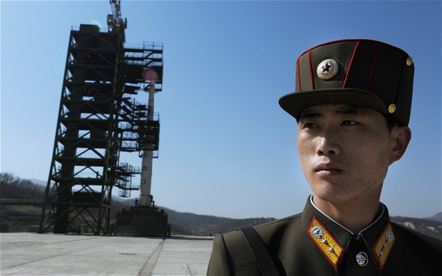 READY FOR LIFTOFF. A North Korean soldier stands guard in front of an Unha-3 rocket at Tangachai -ri space center on April 8, 2012. North Korea has confirmed their intention to launch the rocket this week (between April 12-16) despite international condemnations. AFP Photo/Pedro Ugarte