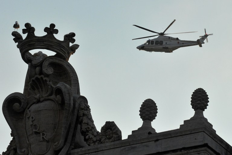 LEAVING VATICAN. A helicopter brings Pope Benedict XVI to his retirement home. Photo from AFP